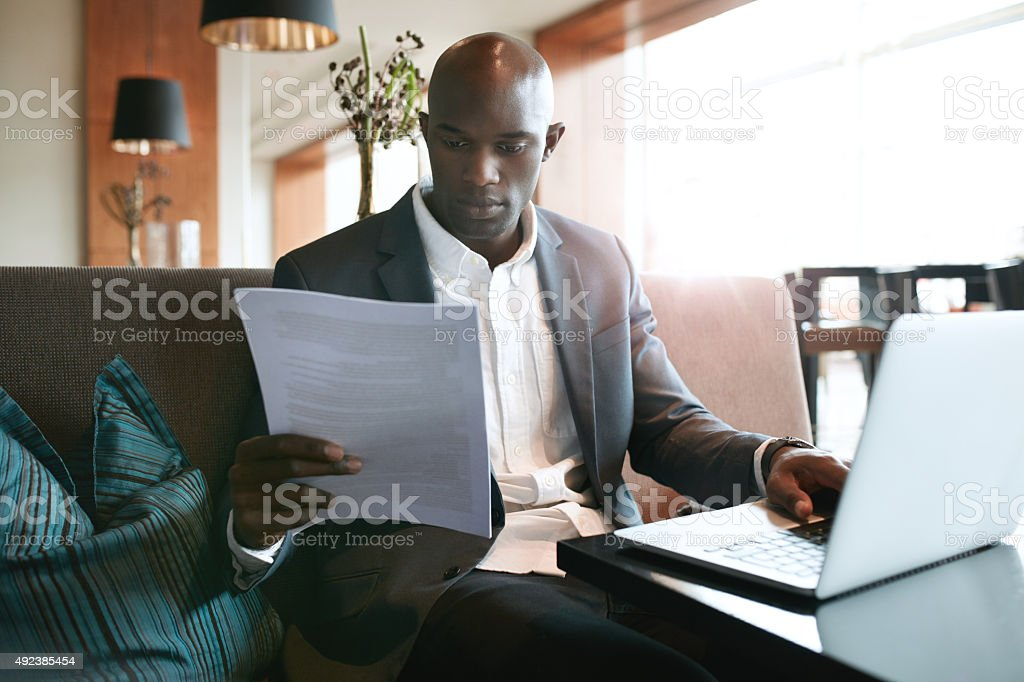 Businessman at cafe preparing himself for a meeting stock photo
