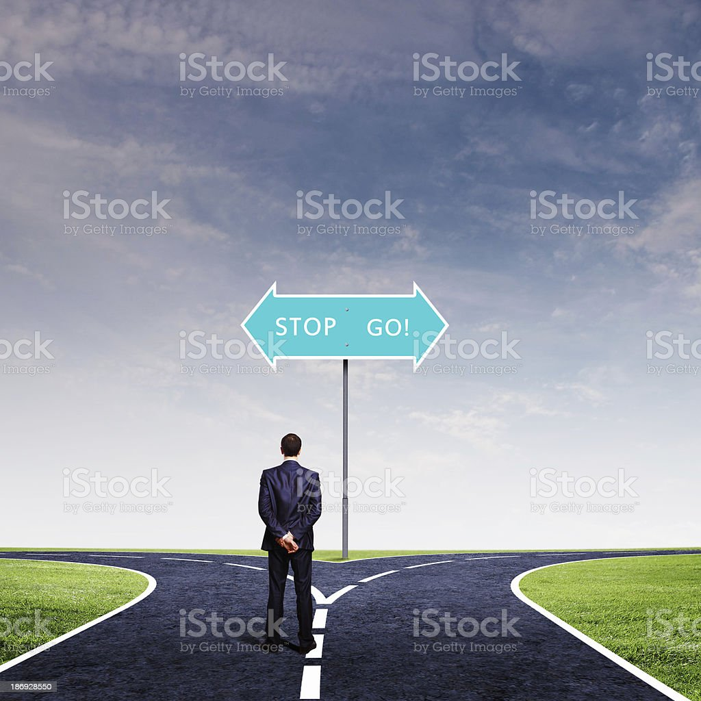 Businessman at crossroads royalty-free stock photo