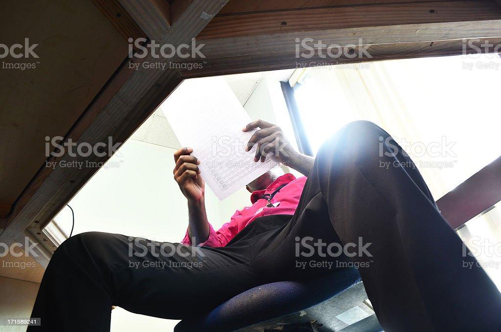 businessman at desk examining document royalty-free stock photo