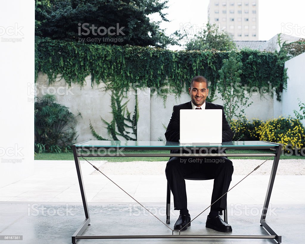 Businessman at desk outdoors royalty-free stock photo