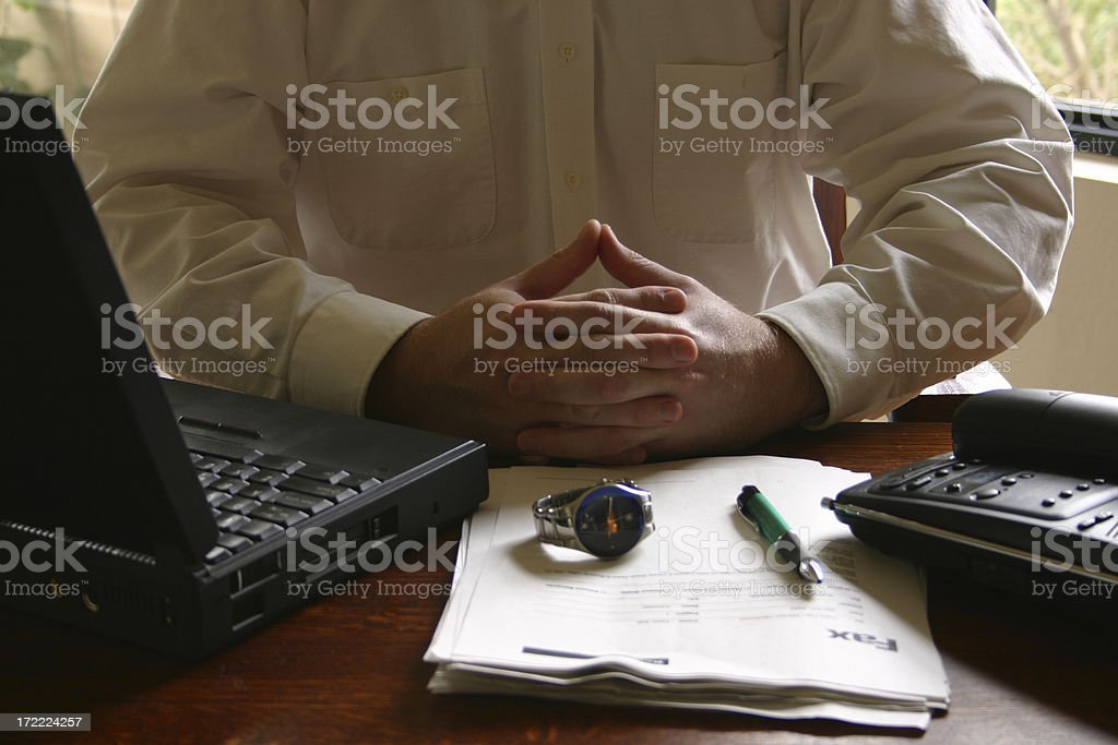 businessman at desk with laptop royalty-free stock photo