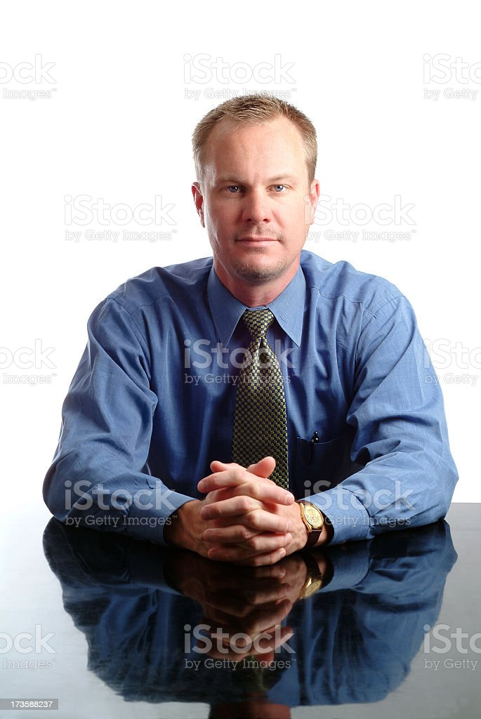 Businessman at his Desk with a Very Serious Expression stock photo