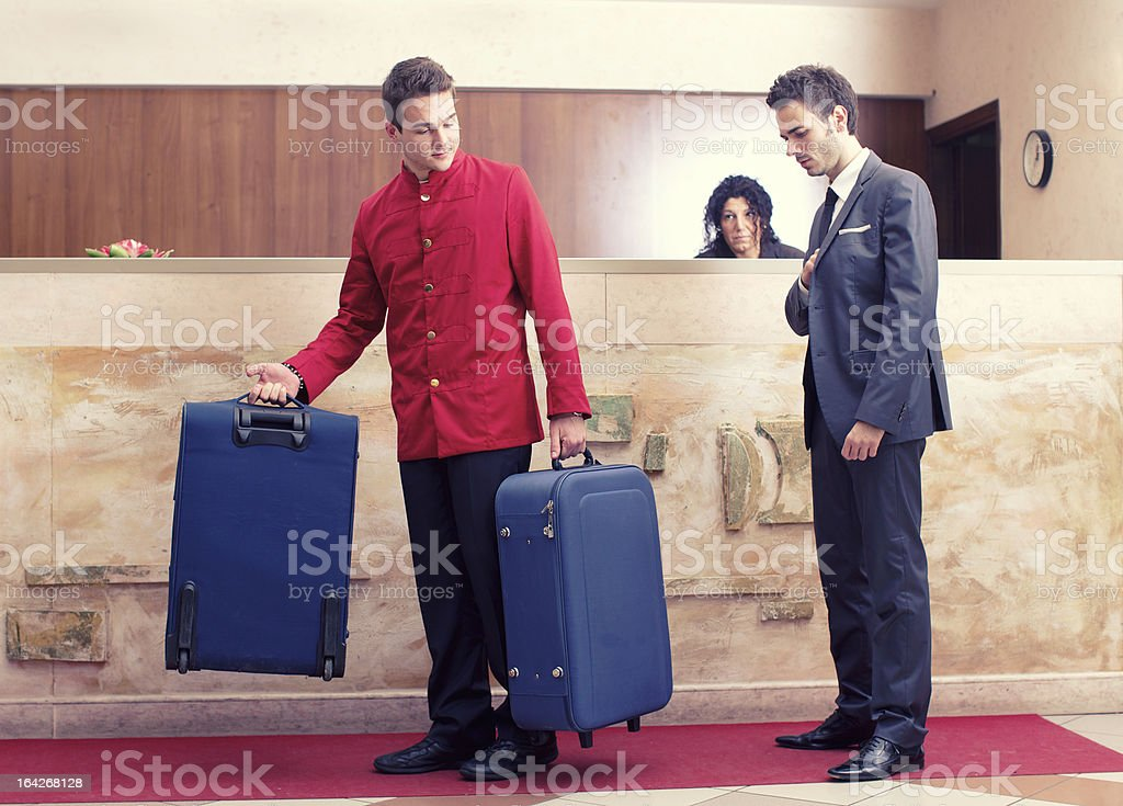 Businessman at hotel lobby stock photo