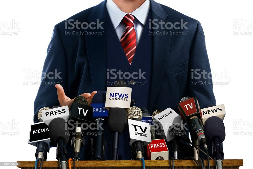 Businessman at Press Conference stock photo