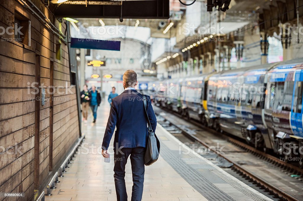 Businessman at the station stock photo