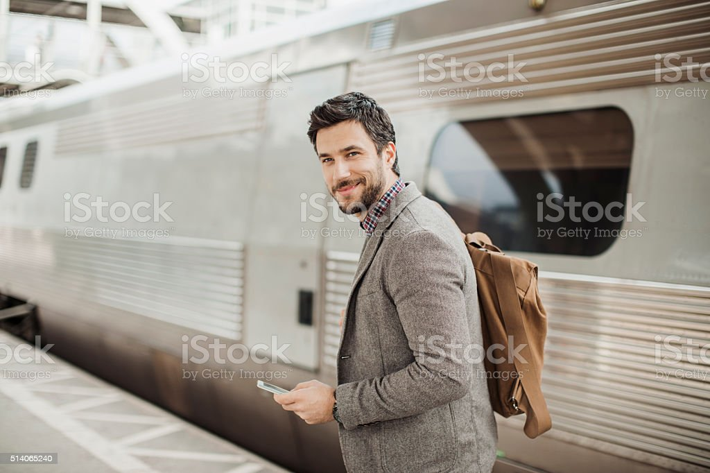 Businessman at train station stock photo