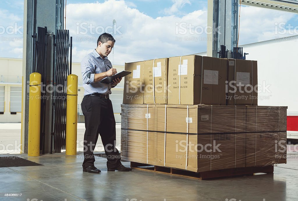 businessman at warehouse stock photo