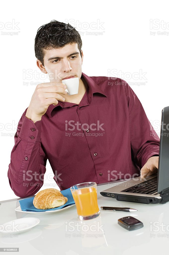 Businessman at work with breakfast royalty-free stock photo