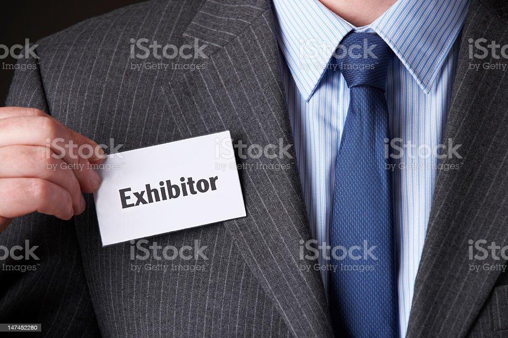 Businessman Attaching Exhibitor Badge To Jacket stock photo