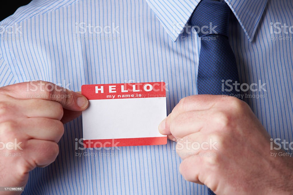 Businessman Attaching Name Tag At Conference stock photo
