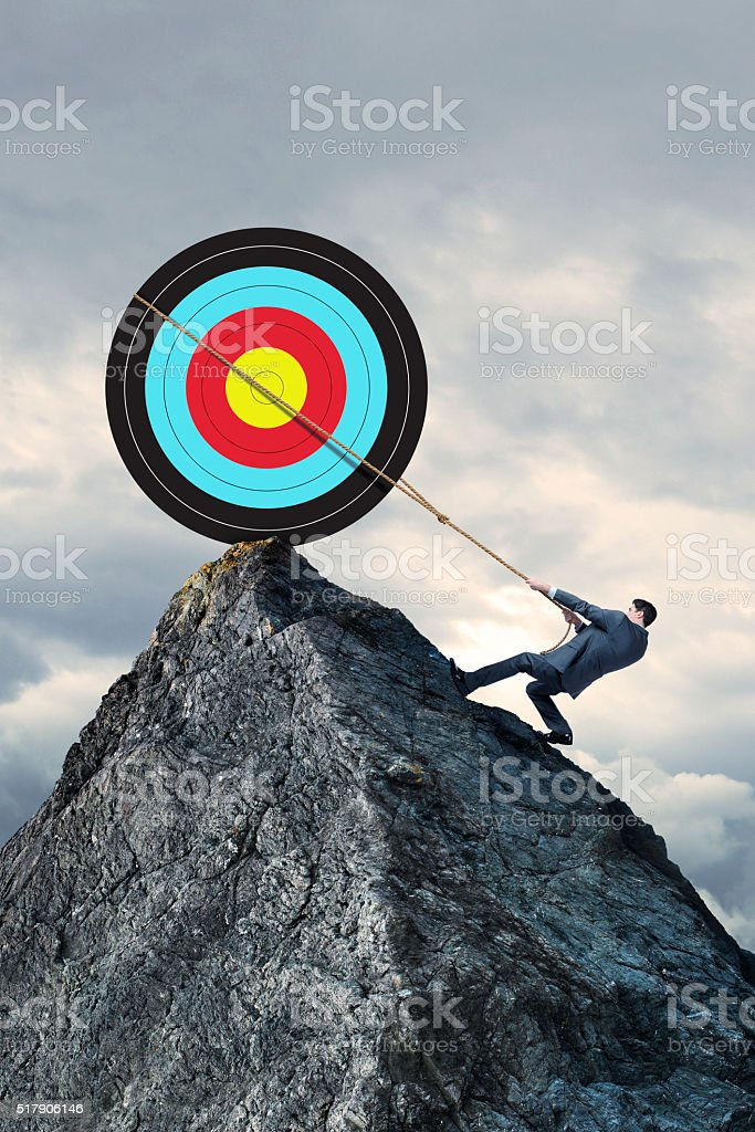 Businessman Attempts To Achieve His Goal By Lassoing Target stock photo