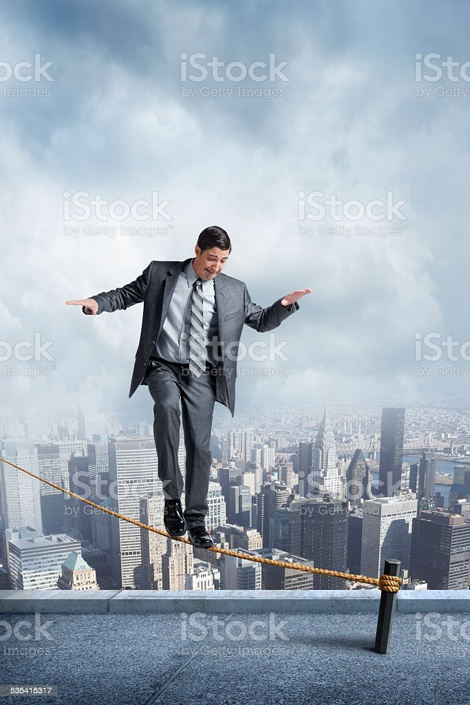 Businessman Balancing On A Tightrope stock photo