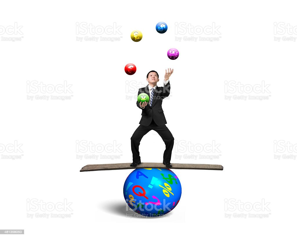 Businessman balancing on sphere juggling with currency symbol ba stock photo
