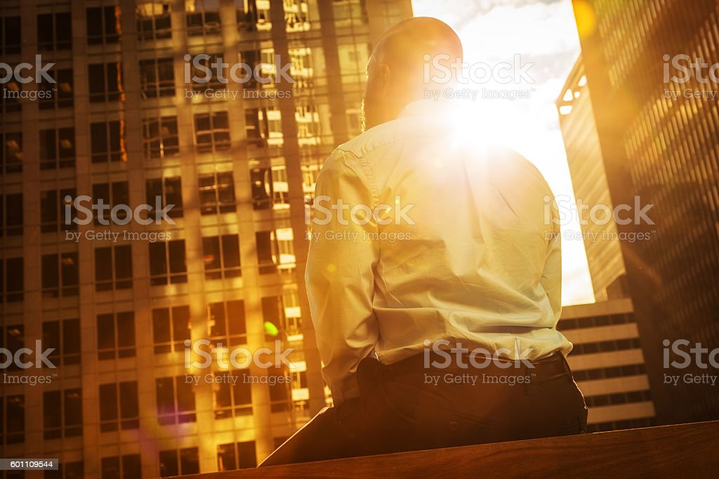 Businessman Bathed in Sunlight stock photo