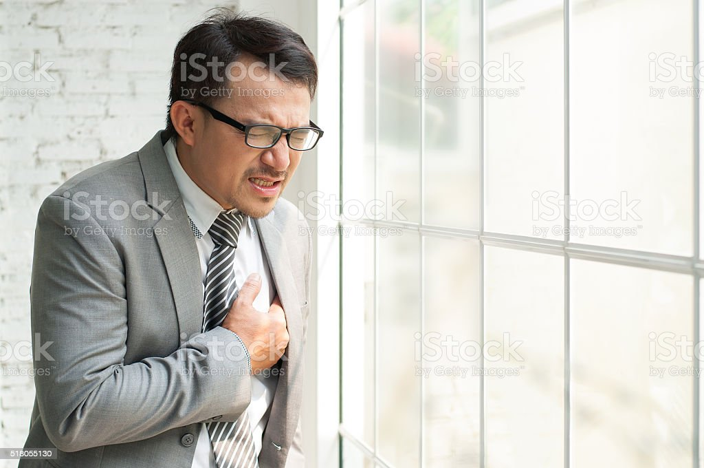 Businessman be ill and heart failure stock photo