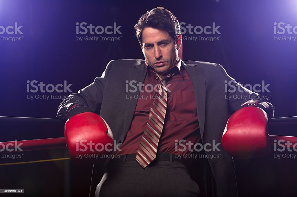 Businessman beat against the ropes stock photo