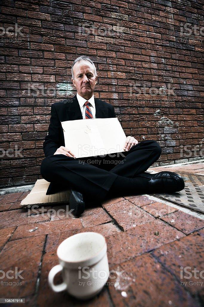 Businessman begging stock photo