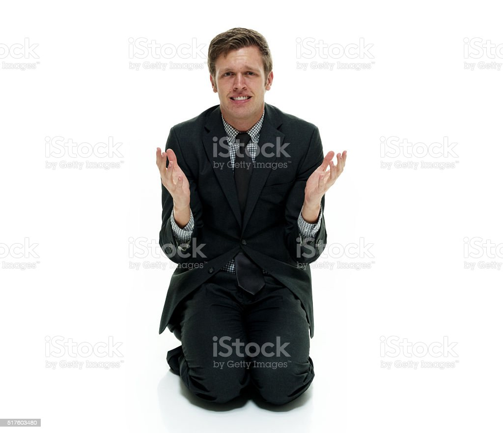 Businessman begging stock photo
