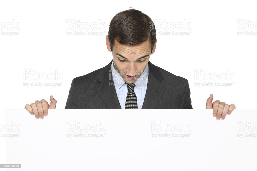 Businessman behind a placard royalty-free stock photo