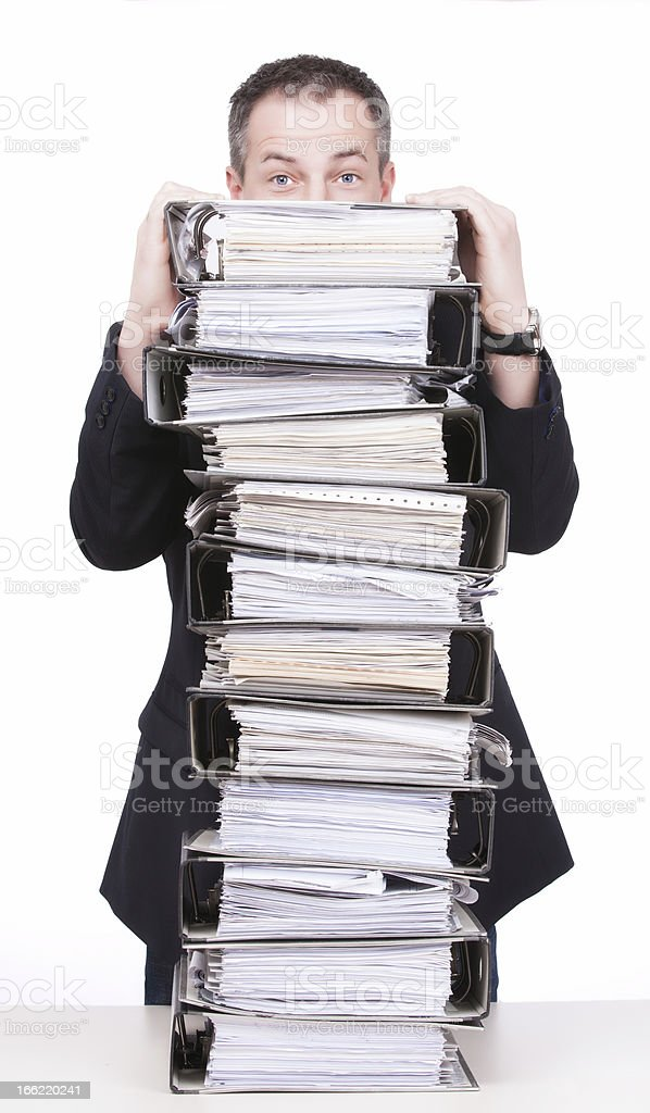 Businessman behind  a stack of binders royalty-free stock photo