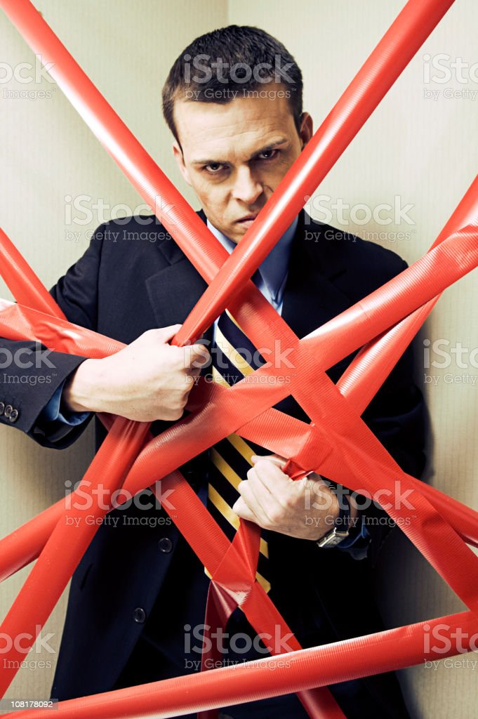 Businessman Behind Red Tape royalty-free stock photo