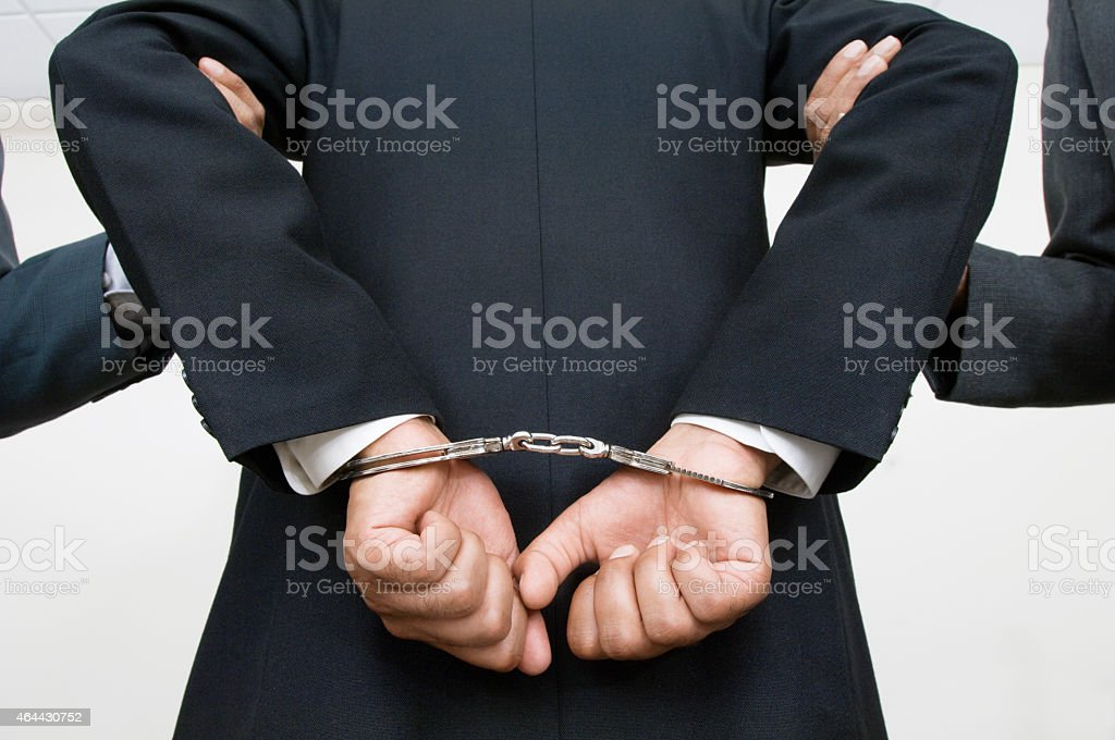 Businessman Being Arrested stock photo