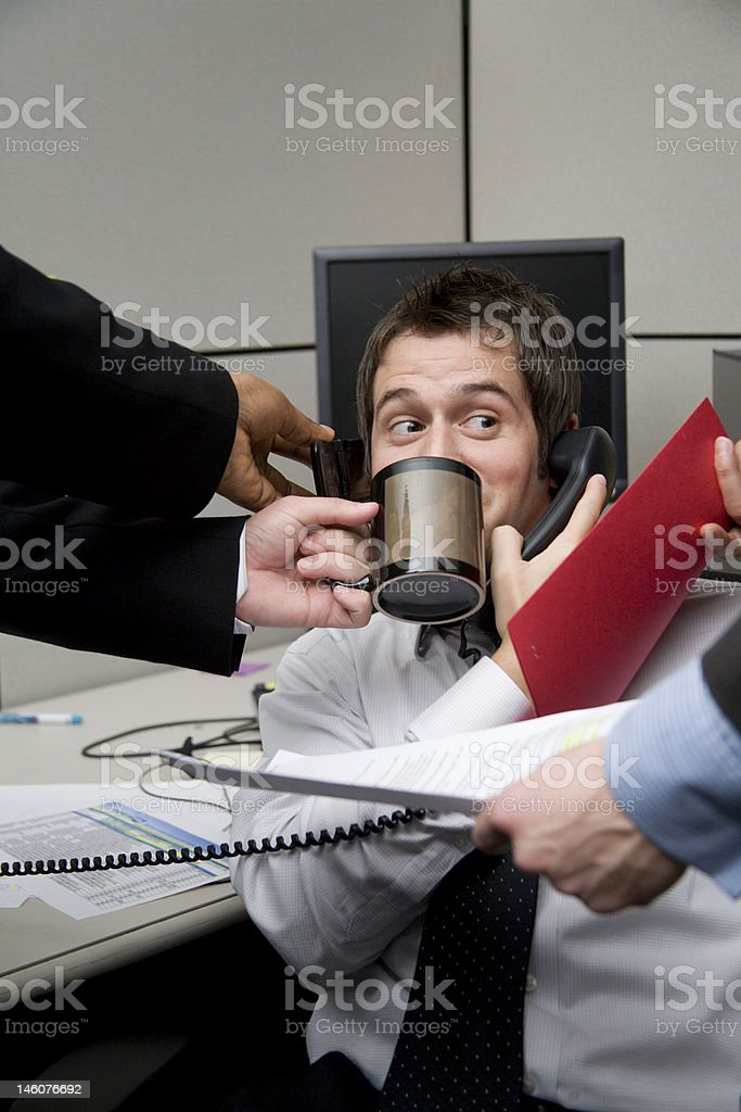 A businessman being bombarded with calls  royalty-free stock photo