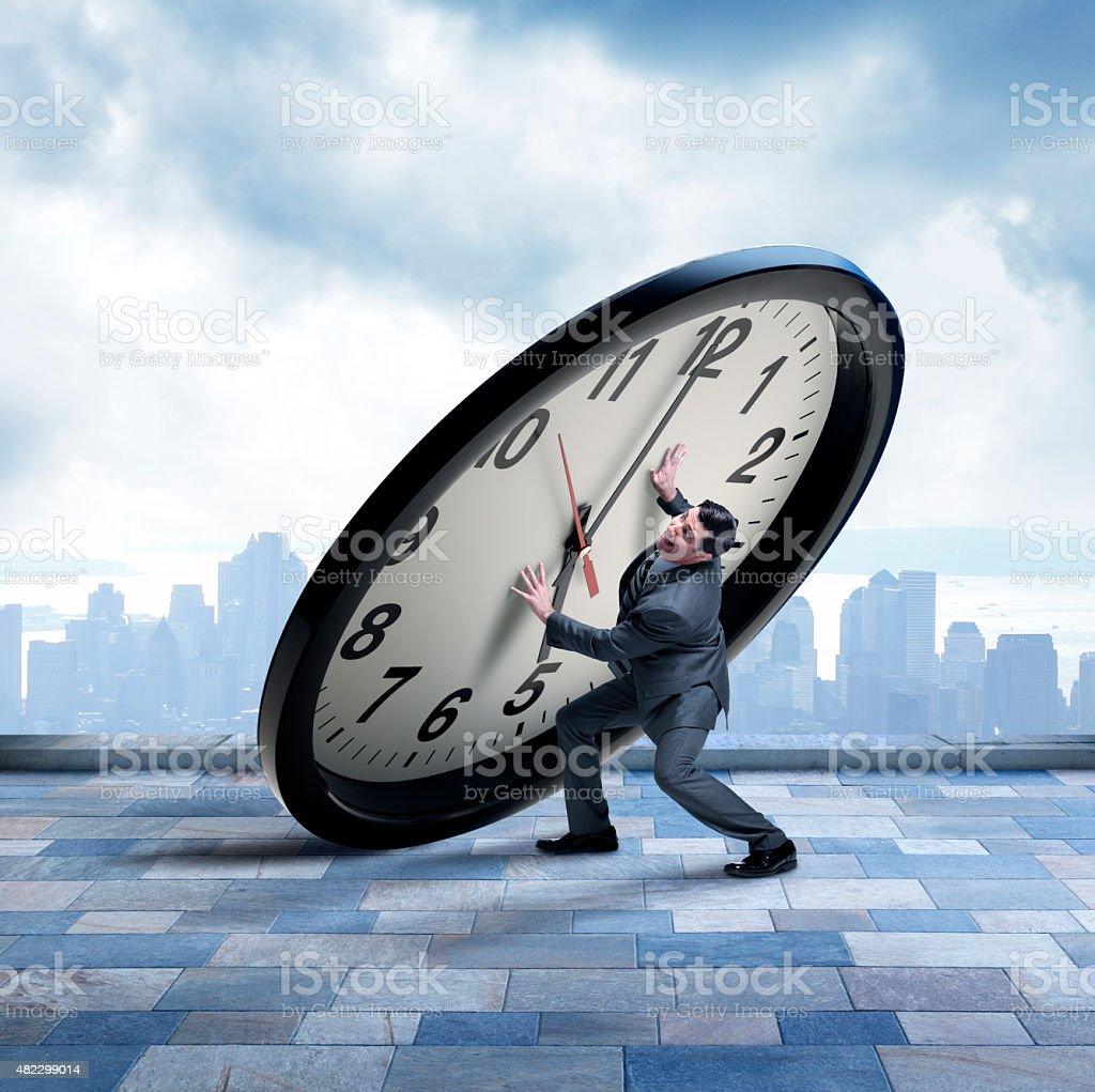 Businessman Being Crushed By Impending Deadline stock photo