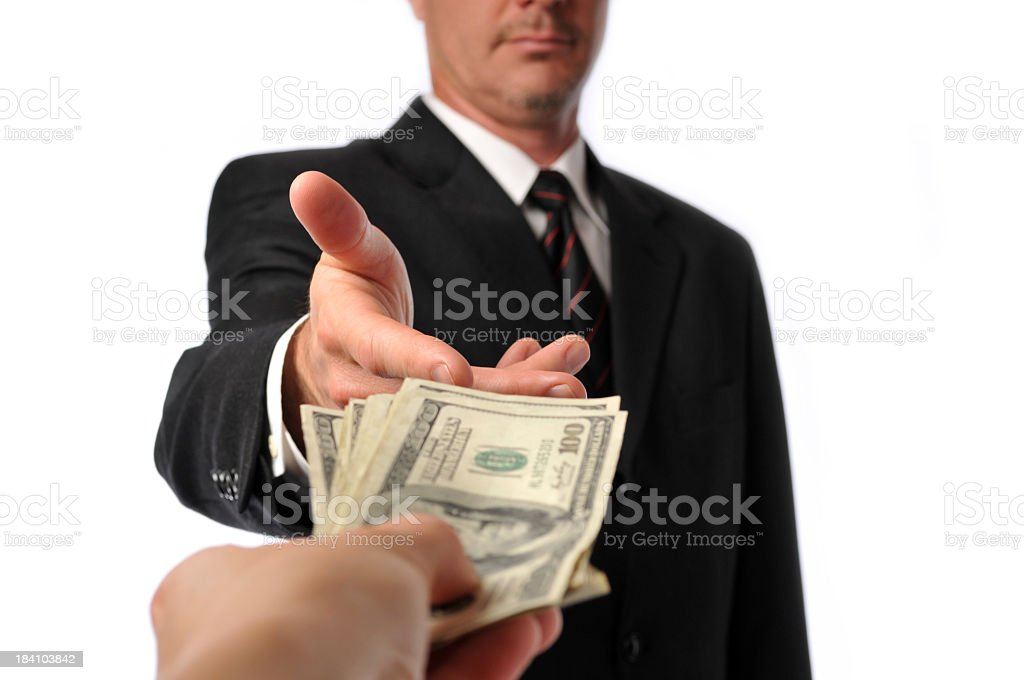 Businessman Being Handed a Stack of Hundred Dollar Bills royalty-free stock photo