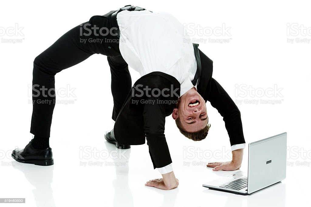 Businessman bending over backwards stock photo