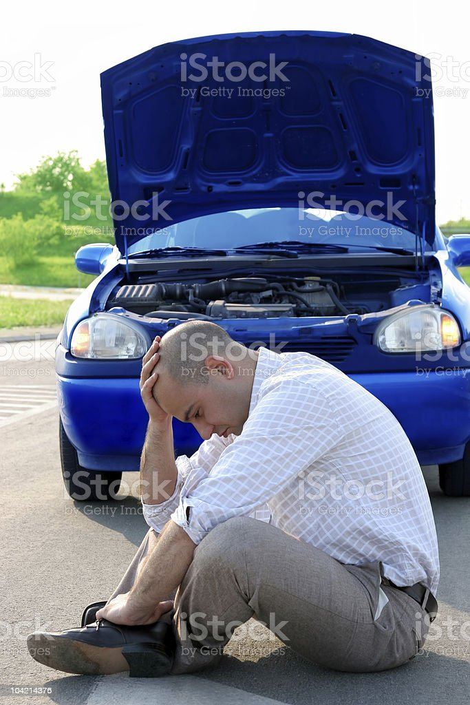 Businessman beside defected a car royalty-free stock photo