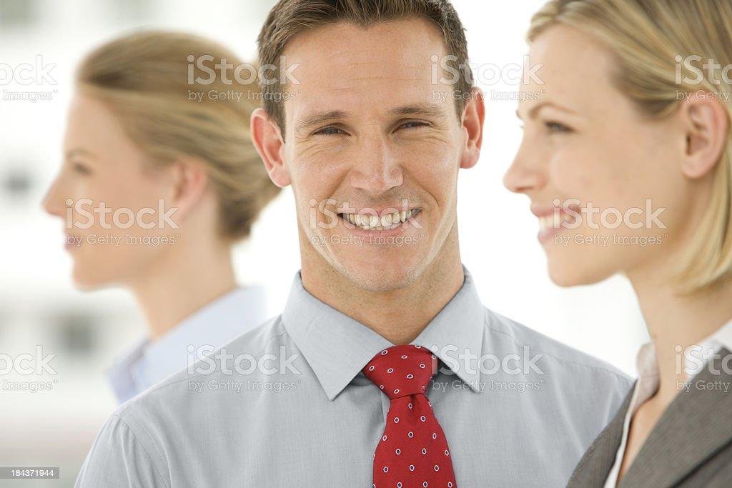 Businessman between two women stock photo
