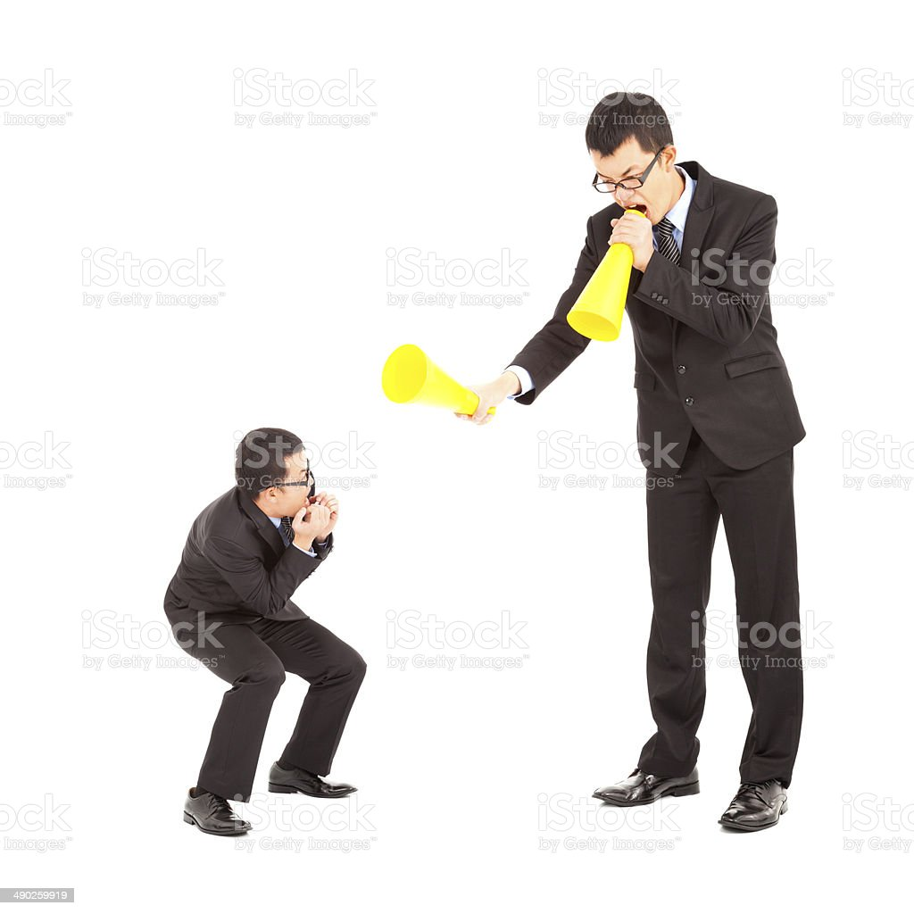 businessman blame or encourage to worker with megaphone stock photo