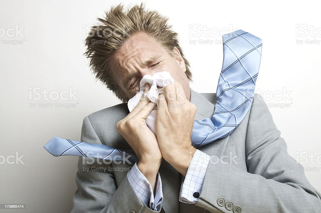 Businessman Blowing His Nose Forcefully stock photo