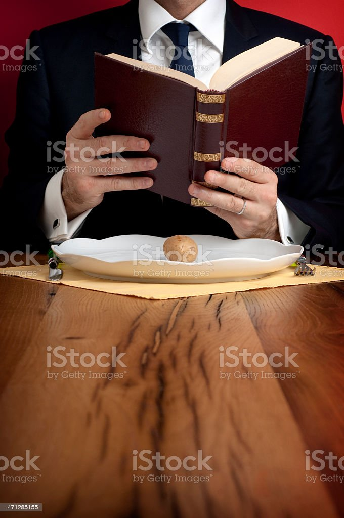 Businessman, book and potato royalty-free stock photo