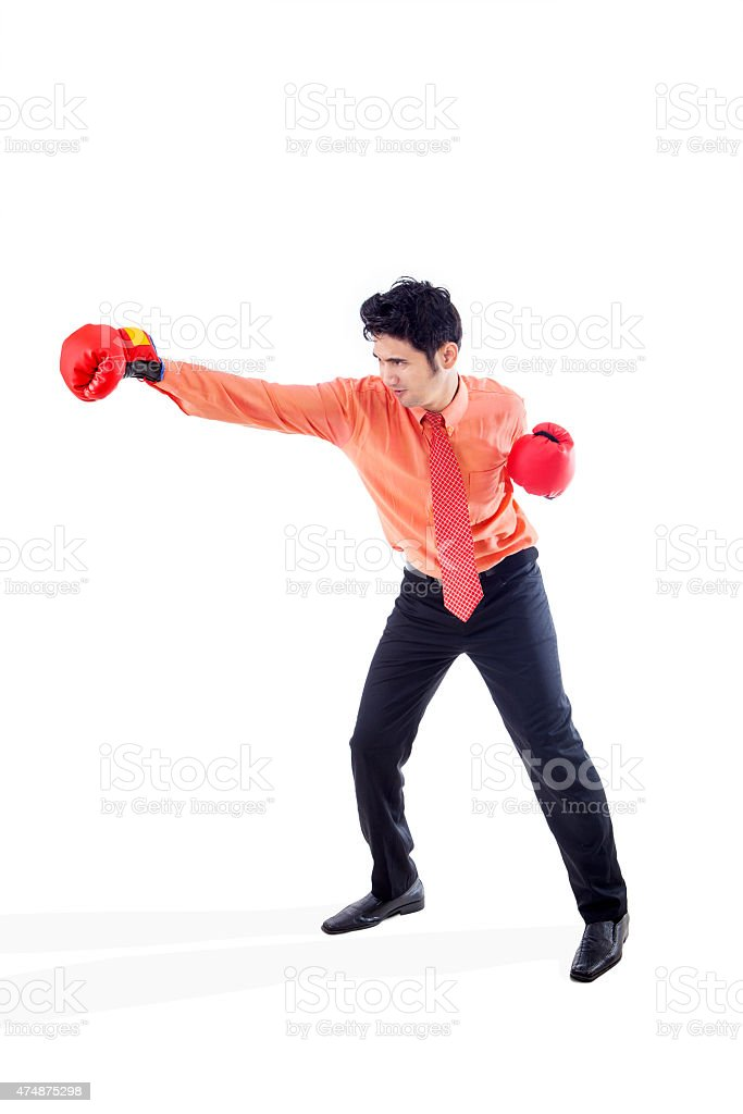Businessman boxing on white stock photo