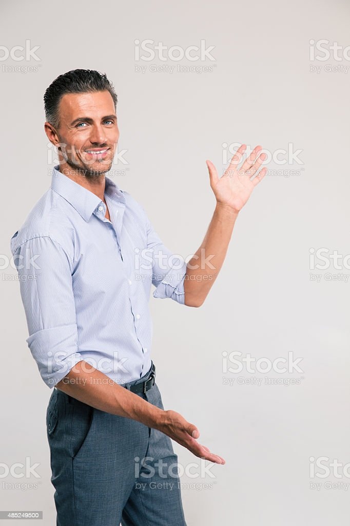 Businessman bragging about the size of something stock photo
