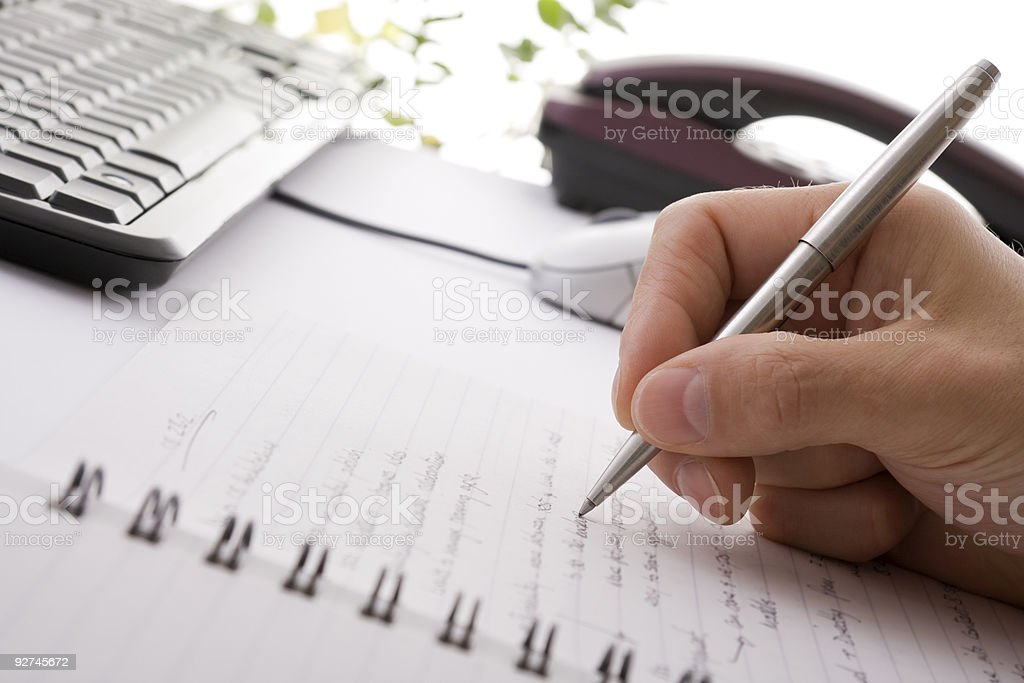 Businessman brainstorming and writing notes stock photo
