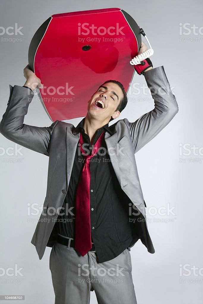 Businessman break mad for go surfing royalty-free stock photo