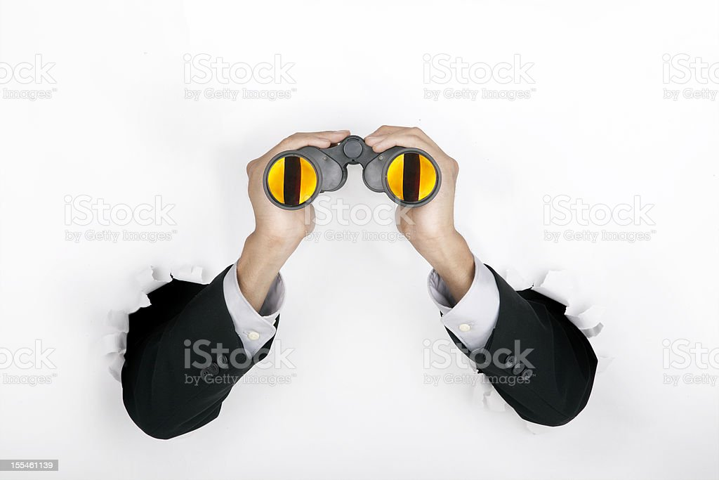 Businessman breaking through a paper wall stock photo