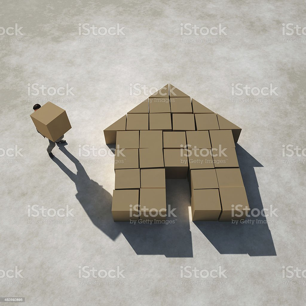 businessman builds a house stock photo