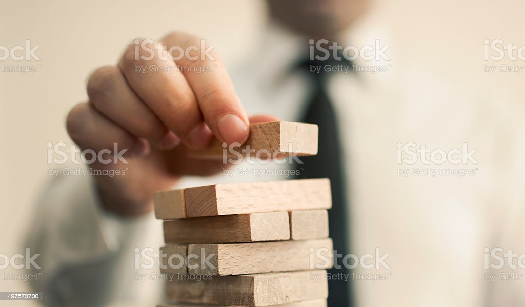 businessman builds a tower stock photo