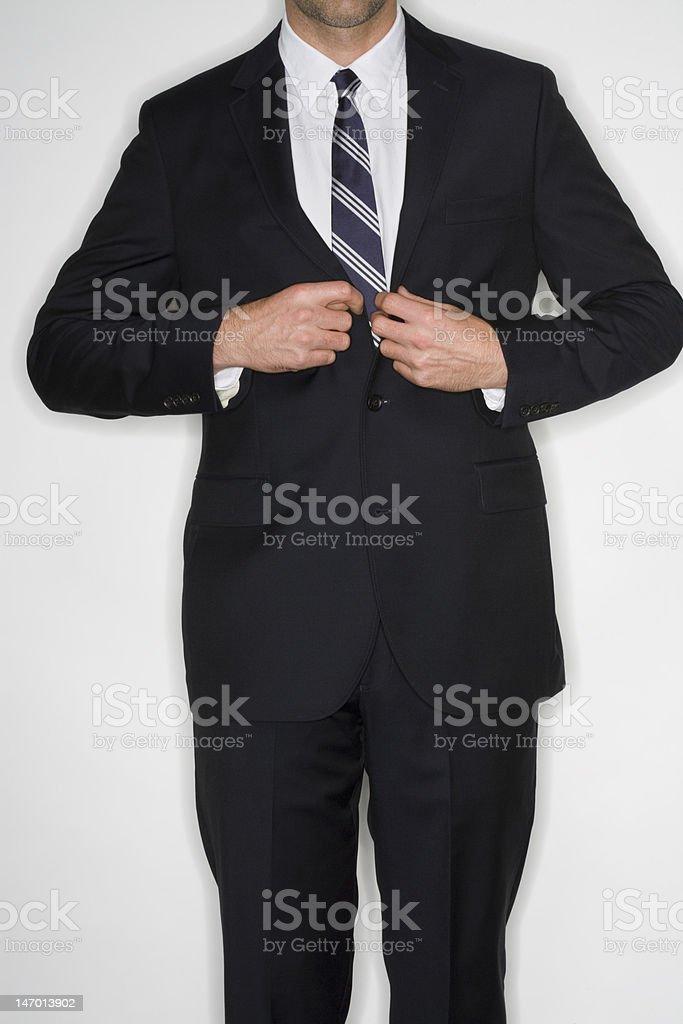 Businessman buttoning jacket royalty-free stock photo