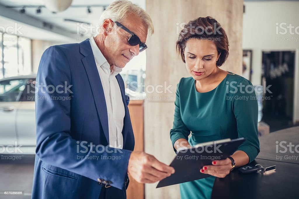 Businessman buying a car stock photo