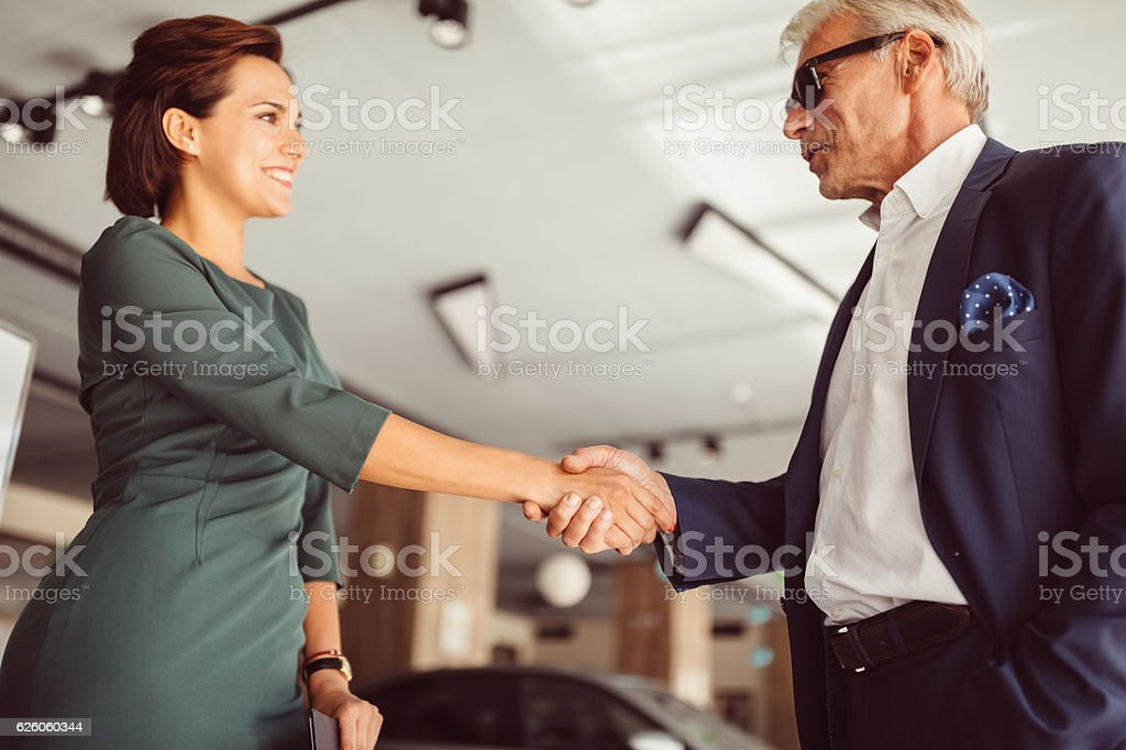 Businessman buying a new car stock photo