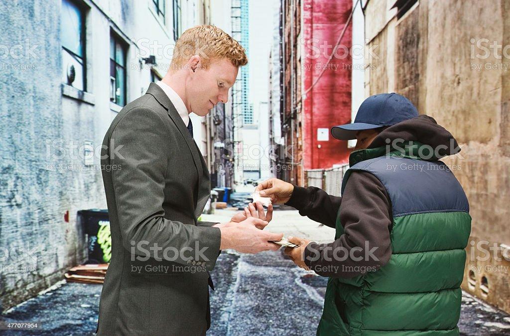 Businessman buying drugs stock photo