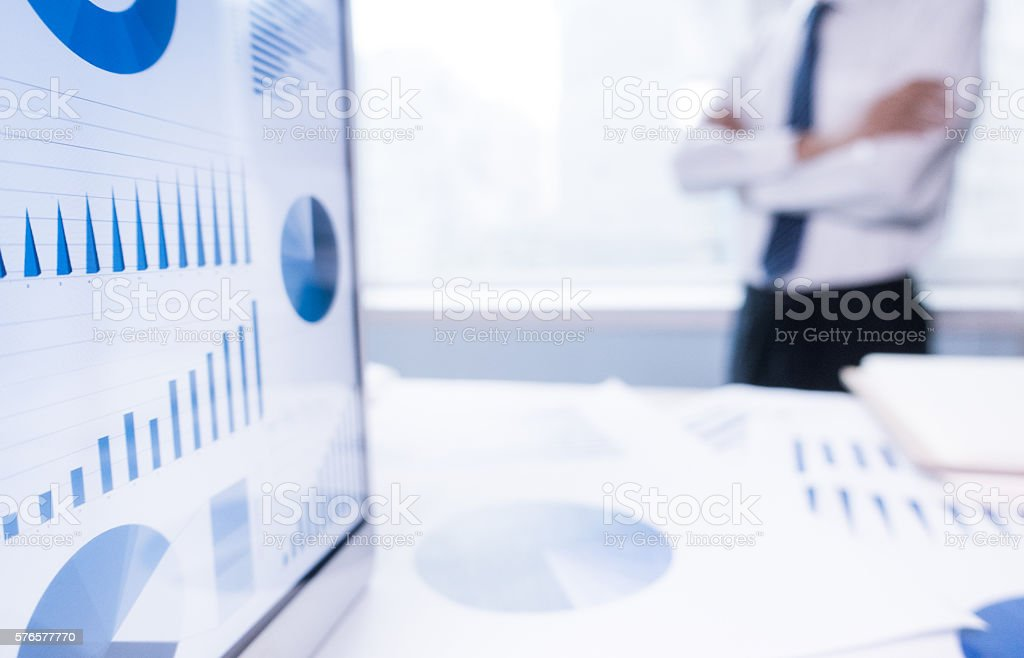 businessman by office window stock photo