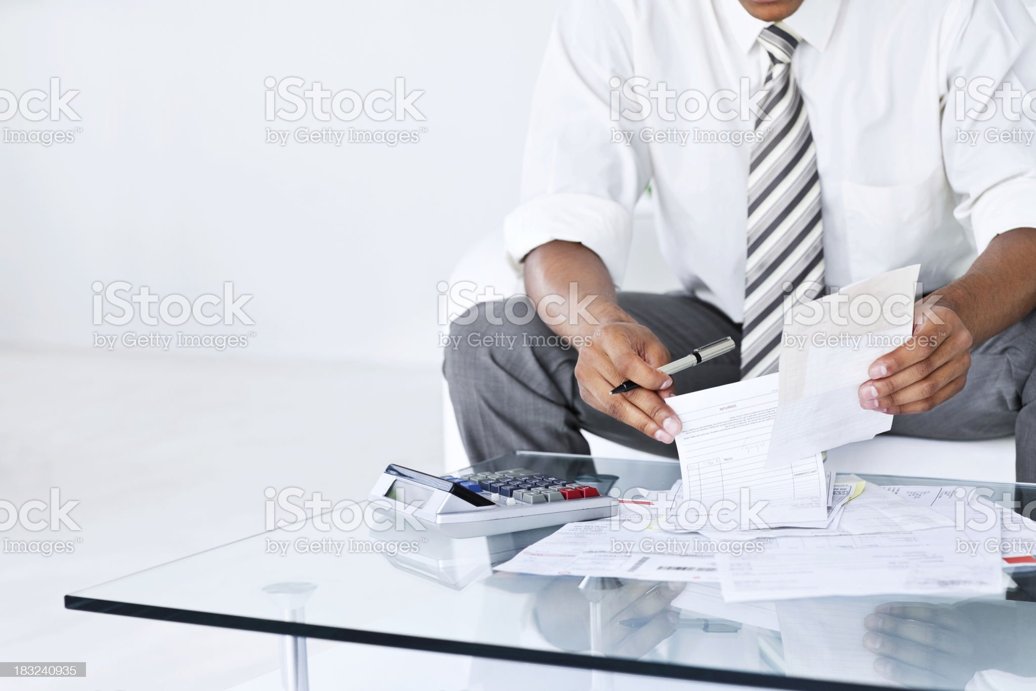 Businessman Calculating Bills royalty-free stock photo