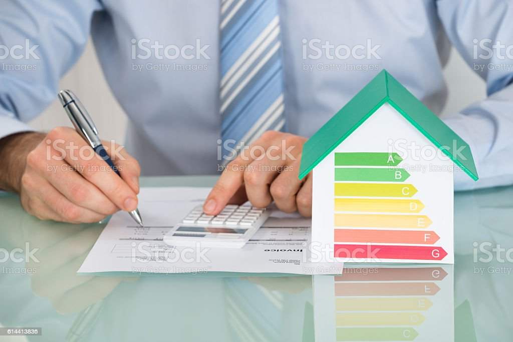Businessman Calculating Energy Efficiency Rate stock photo