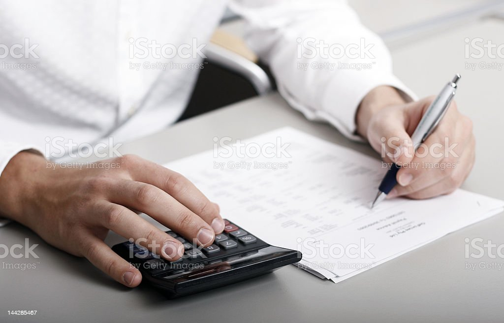 Businessman calculating expenses at tax time royalty-free stock photo